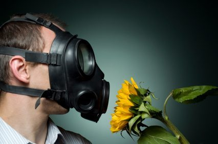 man with air mask smelling flower - Healthy Building Science - environmental consultants
